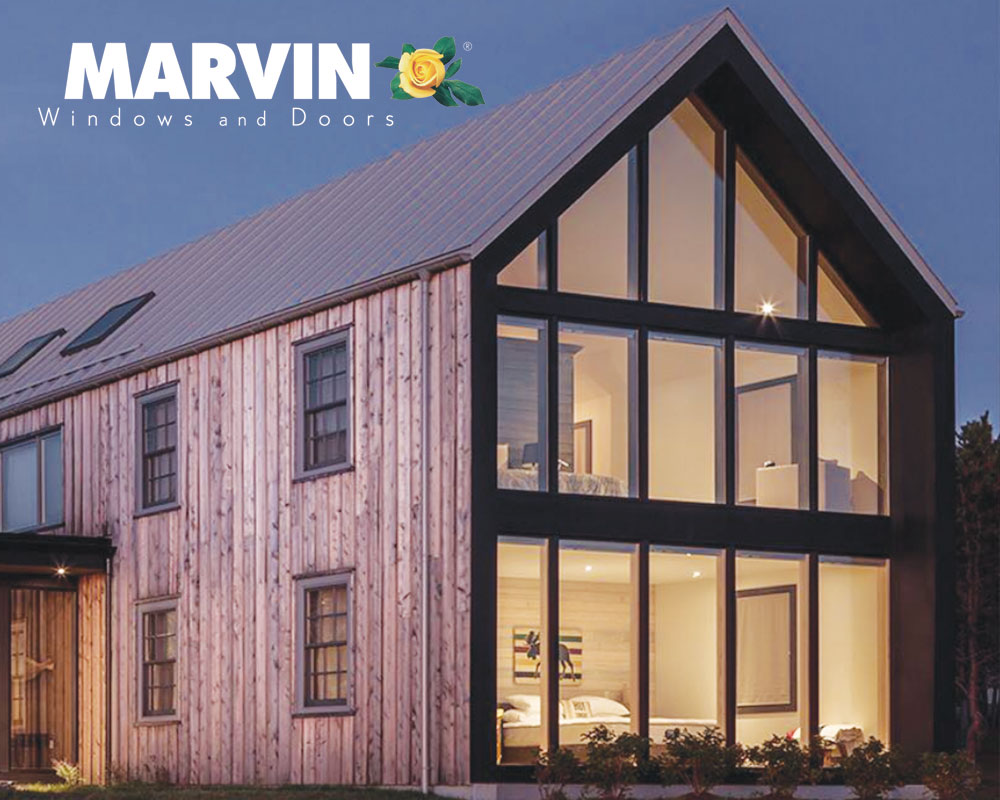 Farmhouse with wall of black framed Marvin Windows